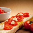 Stock Photo: Toamtoes over bruschetta