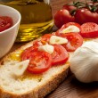 Stock Photo: Tomatoes over bruschetta