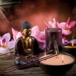 Buddah witn candle and incense — Stock Photo