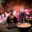 Buddah witn candle and incense - Stock Photo