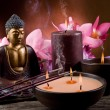 Buddha witn candle and incense - Stock Photo