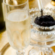 Caviar and champagne — Stock Photo #6428700