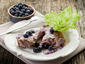 Lamb rib with blueberries sauce — Stock Photo