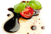 Olive oil balsmaic vinegar tomato and basil — Stock Photo