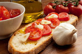 Tomatoes over bruschetta — Stock Photo