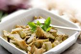 Sauteed artichoke on dish — Stock Photo