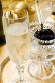 Caviar and champagne — Stock Photo