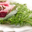 Stock Photo: Raw Tenderloin with herbs