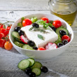 Feta traditional greek cheese and greek salad - Stock Photo