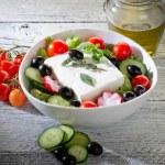 Feta traditional greek cheese and greek salad — Stock Photo