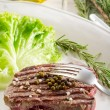Stock Photo: Tenderloin with green salad