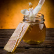 Honey with beeswax and flower - Stock Photo