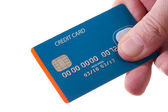 Hand with credit card — Stock Photo