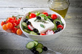 Feta traditional greek cheese and greek salad — Stock Photo