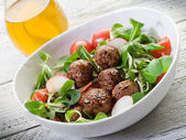 Mixed salad with vegetarian meatballs slice radish and soy spro — Stock Photo