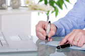 Writing check businnes concept — Stock Photo