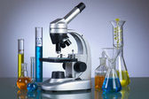 Microscope with laboratory elements — Stock Photo