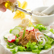 Stock Photo: Olive oil over tunsalad