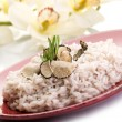 Royalty-Free Stock Photo: Rice with truffle over red dish