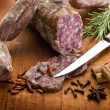 Slice salami, susage and spice over cutting board — Stock Photo