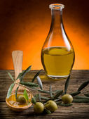 Olive oil over wood spoon — Stock Photo