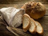 Bread ear and flour — Stock Photo