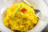 Saffron rice on dish — Stock Photo