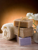 Natural soap with towel and flower — Stock Photo