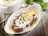 Tenderloin with cream sauce ovum mushroom and arugula salad — Photo