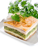 Quiche with ham cheese and spinach — Stock Photo