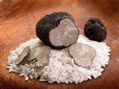 Sliced black truffle over wood background — Stock Photo
