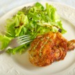 Chicken leg with green salad — Stock Photo