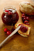 Cherry jam with slice bread — Stock Photo