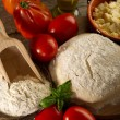 Dough and ingredients for homemade pizza — Stock Photo #6476850