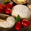 Dough and ingredients for homemade pizza — Stock Photo #6476854