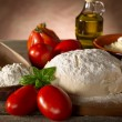 Dough and ingredients for homemade pizza — Stock Photo