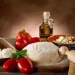 Dough and ingredients for homemade pizza — Stock Photo #6476897