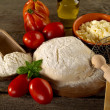 Stock Photo: Dough and ingredients for homemade pizza