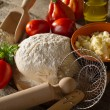 Dough and ingredients for homemade pizza — Stock Photo #6476915