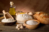 Dough and ingredients for homemade bread — Stok fotoğraf