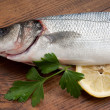 Seabass with ingredients ready to cooking - Stock Photo