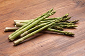Asparagus on wood background — Stock Photo