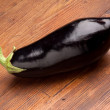 Eggplant on wood background — Stock Photo #6490601