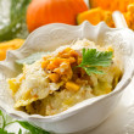 Pumpkin ravioli with parmesan cheese — Stock Photo