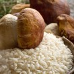 Raw rice and cep mushroom — Stock Photo #6492247
