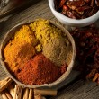 Variety of spice on wood background - Foto Stock