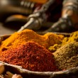 Variety of spice on wood background - Foto de Stock