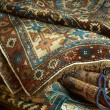 Variety of ancient oriental carpets - Stock Photo