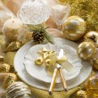 Gold xmas table with decorations — Stock Photo