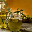 Olive oil on wood background - Stock Photo